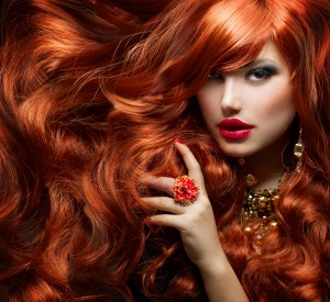 Long Curly Red Hair. Fashion Woman Portrait